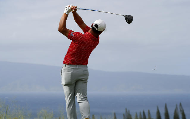 Gary Woodland plays his shot from the 18th tee during the third round of the Tournament of Champions golf event, Saturday, Jan. 5, 2019, at Kapalua Plantation Course in Kapalua, Hawaii. (AP Photo/Matt York)