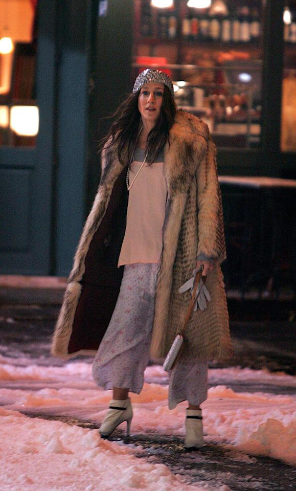 11. On a depressing New Year's Eve, Carrie bundled up in this hobo-like look (topped with a sequined beret!) before braving the elements and heading to Brooklyn to cheer up a heartbroken Miranda. That's what friends are for!
