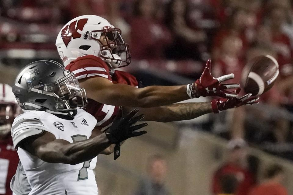 Eastern Michigan's Freddie McGee III breaks up a pass intended for Wisconsin's Danny Davis III during the second half of an NCAA college football game Saturday, Sept. 11, 2021, in Madison, Wis. (AP Photo/Morry Gash)