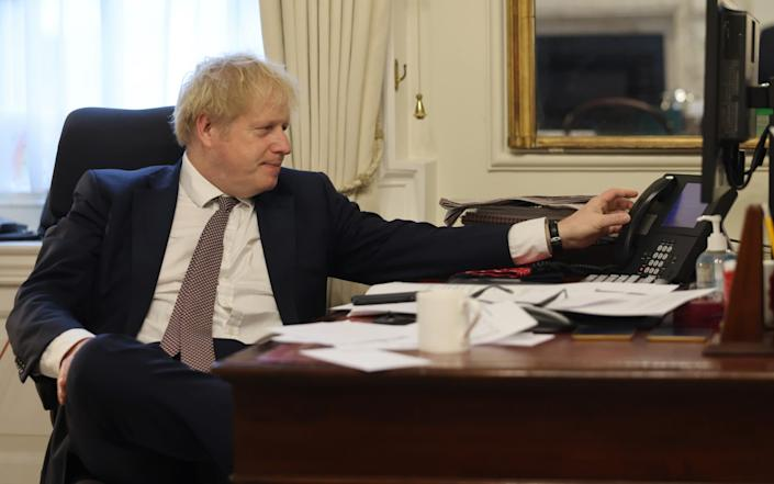 The Prime Minister Boris Johnson speaks to the President of the European Commission Ursula von der Leyen from his desk inside No10 Downing Street - Andrew Parsons/No 10 Downing Street