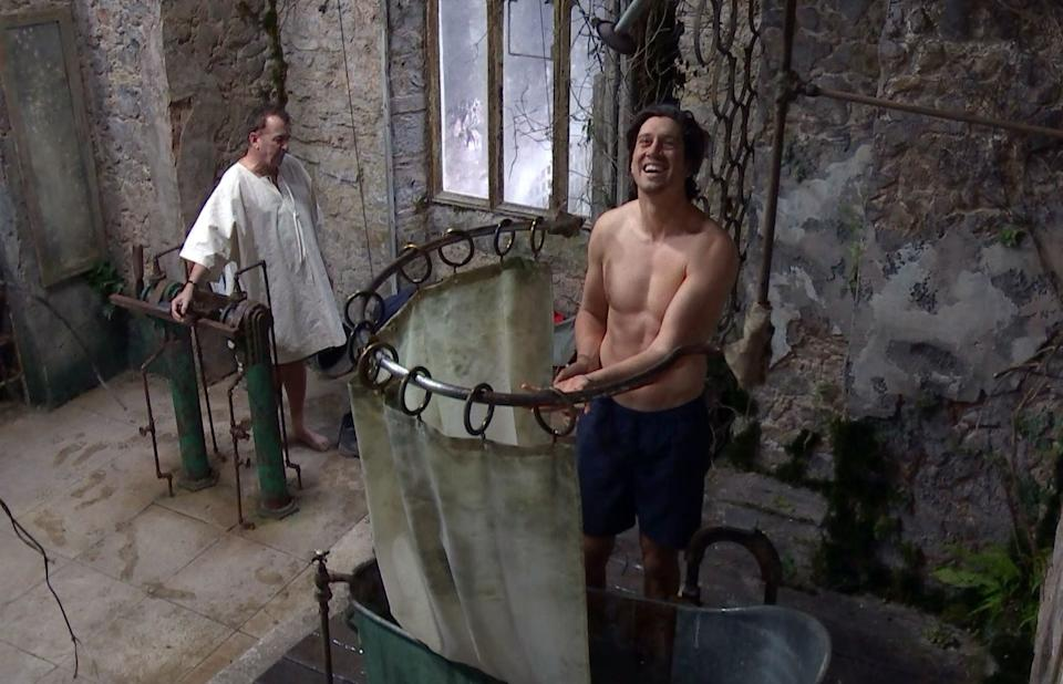 Vernon Kay takes a shower on I'm A Celeb. (ITV/Shutterstock)