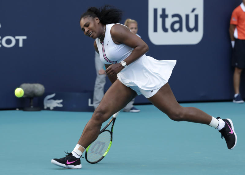 FILE - In this March 22, 2019, file photo, Serena Williams can't get to a ball hit by Rebecca Peterson, of Sweden, during the Miami Open tennis tournament in Miami Gardens, Fla. With the French Open set to start Sunday, May 26, the 10th-ranked Williams has played only nine matches in 2019. The tennis world cant wait to find out exactly how that bothersome left knee is holding up. (AP Photo/Lynne Sladky, File)