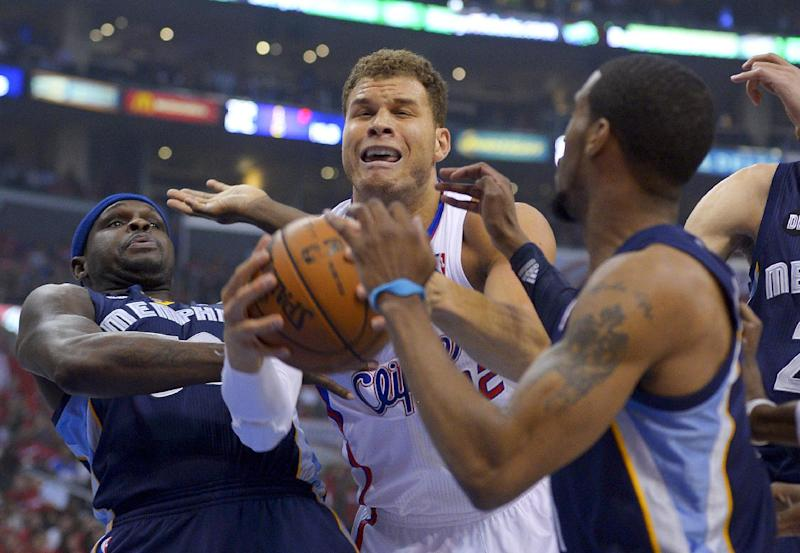 Los Angeles Clippers forward Blake Griffin, middle, drives between Memphis Grizzlies forward Zach Randolph, left, and Mike Conley during the first half of Game 2 of a first-round NBA basketball playoff series, Monday, April 22, 2013, in Los Angeles. (AP Photo/Mark J. Terrill)