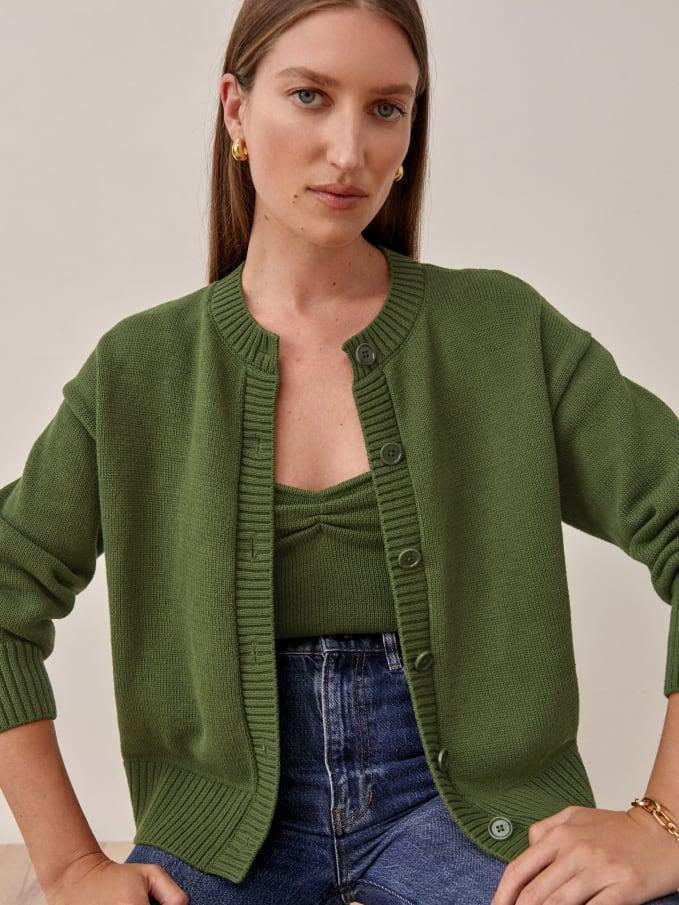 """<h2>The Matching Cardigan Set</h2><br>The best thing about a <a href=""""https://www.refinery29.com/en-us/matching-sets"""" rel=""""nofollow noopener"""" target=""""_blank"""" data-ylk=""""slk:matching set"""" class=""""link rapid-noclick-resp"""">matching set</a> is that you get all the points for a polished look without putting in the effort usually required to pull it off. Cardigans that come with a specific top or cami make coordinating your ensemble easier than ever. <br><br><strong>Reformation</strong> Capello Cotton Tank And Cardi Set, $, available at <a href=""""https://go.skimresources.com/?id=30283X879131&url=https%3A%2F%2Fwww.thereformation.com%2Fproducts%2Fcapello-cotton-tank-and-cardi-set%3Fcolor%3DOlive"""" rel=""""nofollow noopener"""" target=""""_blank"""" data-ylk=""""slk:Reformation"""" class=""""link rapid-noclick-resp"""">Reformation</a>"""