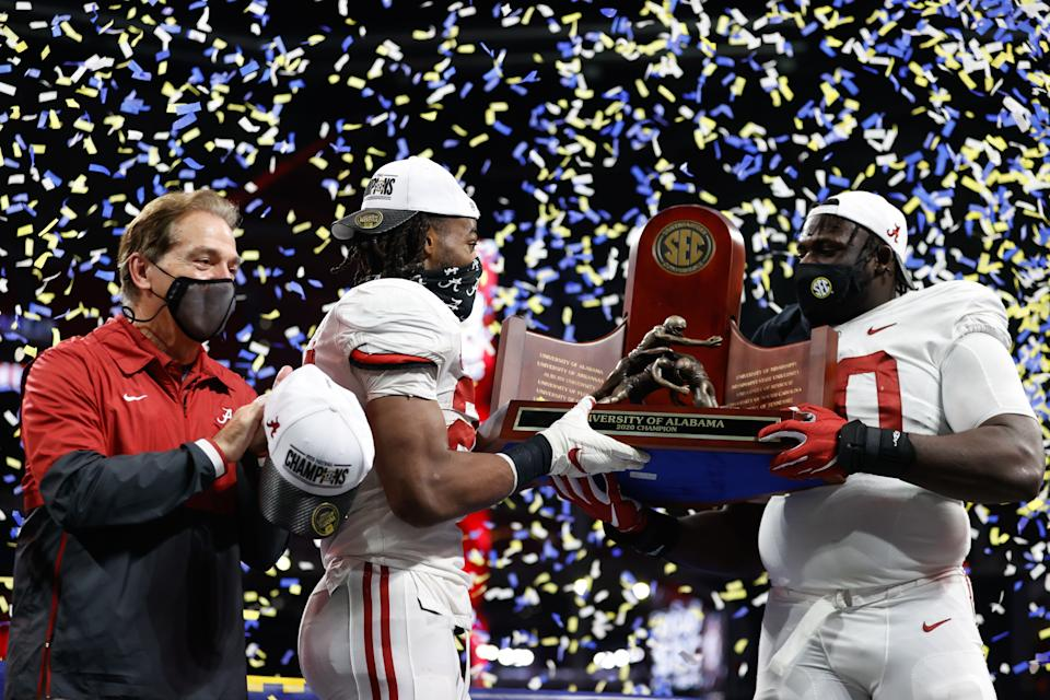 ATLANTA, GA - DECEMBER 19: Head Coach Nick Saban, Alex Leatherwood #70, and Najee Harris #22 of the Alabama Crimson Tide holding the SEC Championship trophy after the victory over the Florida Gators at Mercedes-Benz Stadium on December 19, 2020 in Atlanta, Georgia. (Photo by UA Athletics/Collegiate Images/Getty Images)