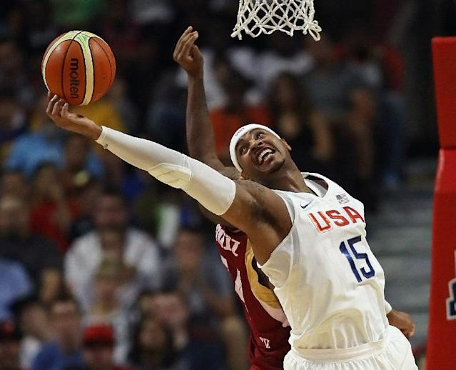 Carmelo Anthony of the United States grabs a rebound over Miguel Ruiz of Venezuela during their pre-Olympic exhibition game in Chicago, Illinois (AFP Photo/Jonathan Daniel)