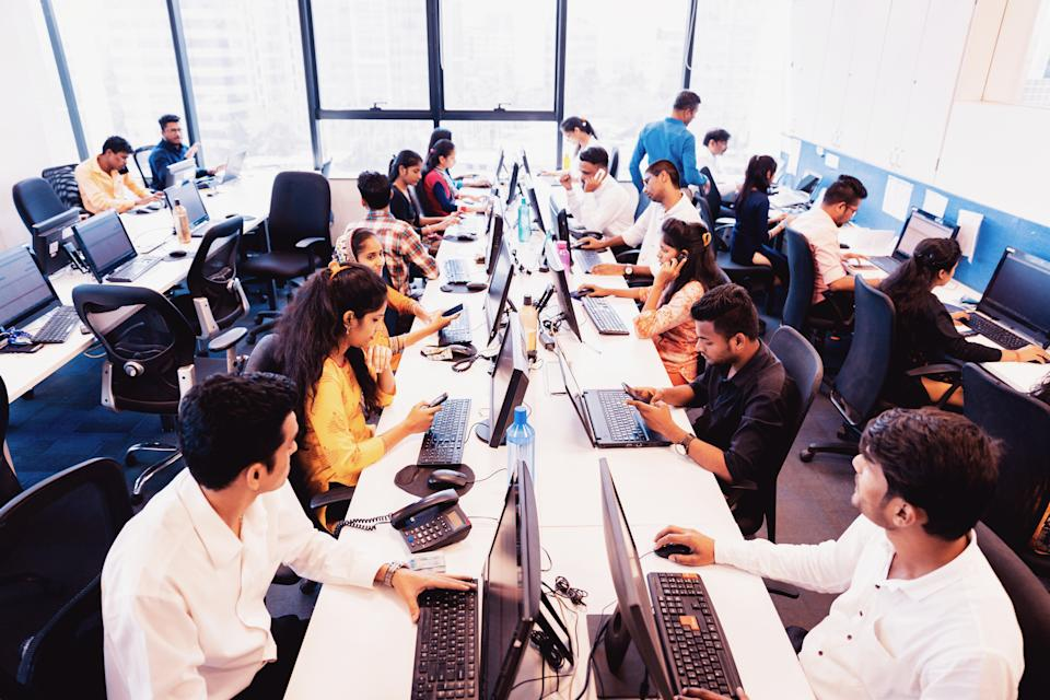 Corporate Business, Indian, Office - Group of Customer Service Executives Attending Calls at a Busy Call Centre