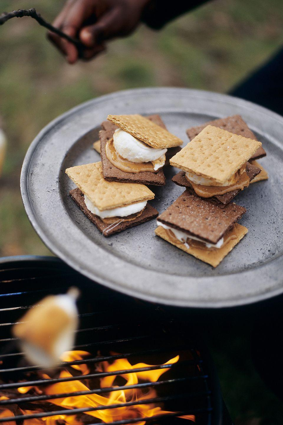 """<p>Grab some skewers and get roasting! Use your marshmallows to make the classic treat or try another recipe <a href=""""https://www.countryliving.com/food-drinks/g2006/smores-dessert-recipes/"""" rel=""""nofollow noopener"""" target=""""_blank"""" data-ylk=""""slk:like s'mores nachos or s'mores brownies"""" class=""""link rapid-noclick-resp"""">like s'mores nachos or s'mores brownies</a>.</p>"""