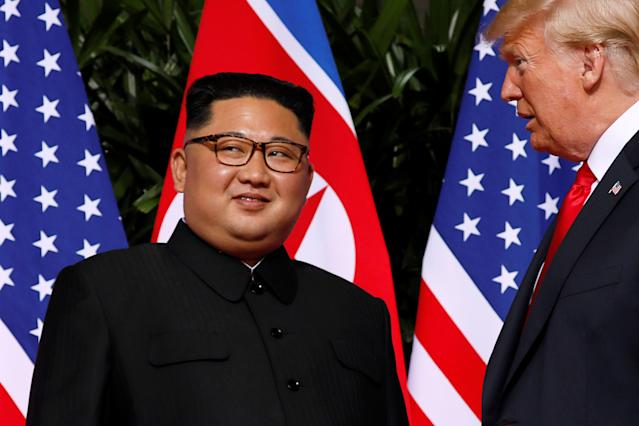 <p>U.S. President Donald Trump and North Korea leader Kim Jong Un stop to talk with the media as they walk from their lunch at the Capella resort on Sentosa Island Tuesday, June 12, 2018 in Singapore. (Photo: Evan Vucci/AP) </p>