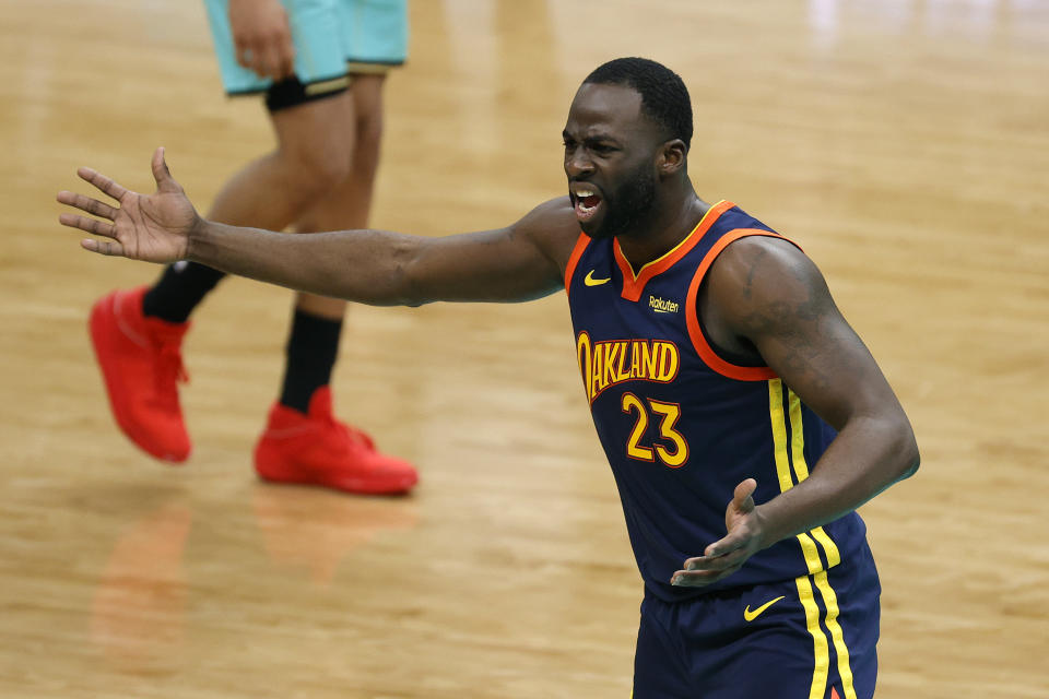 CHARLOTTE, NORTH CAROLINA - FEBRUARY 20: Draymond Green #23 of the Golden State Warriors reacts following a call during the fourth quarter of their game against the Charlotte Hornets at Spectrum Center on February 20, 2021 in Charlotte, North Carolina. NOTE TO USER: User expressly acknowledges and agrees that, by downloading and or using this photograph, User is consenting to the terms and conditions of the Getty Images License Agreement. (Photo by Jared C. Tilton/Getty Images)