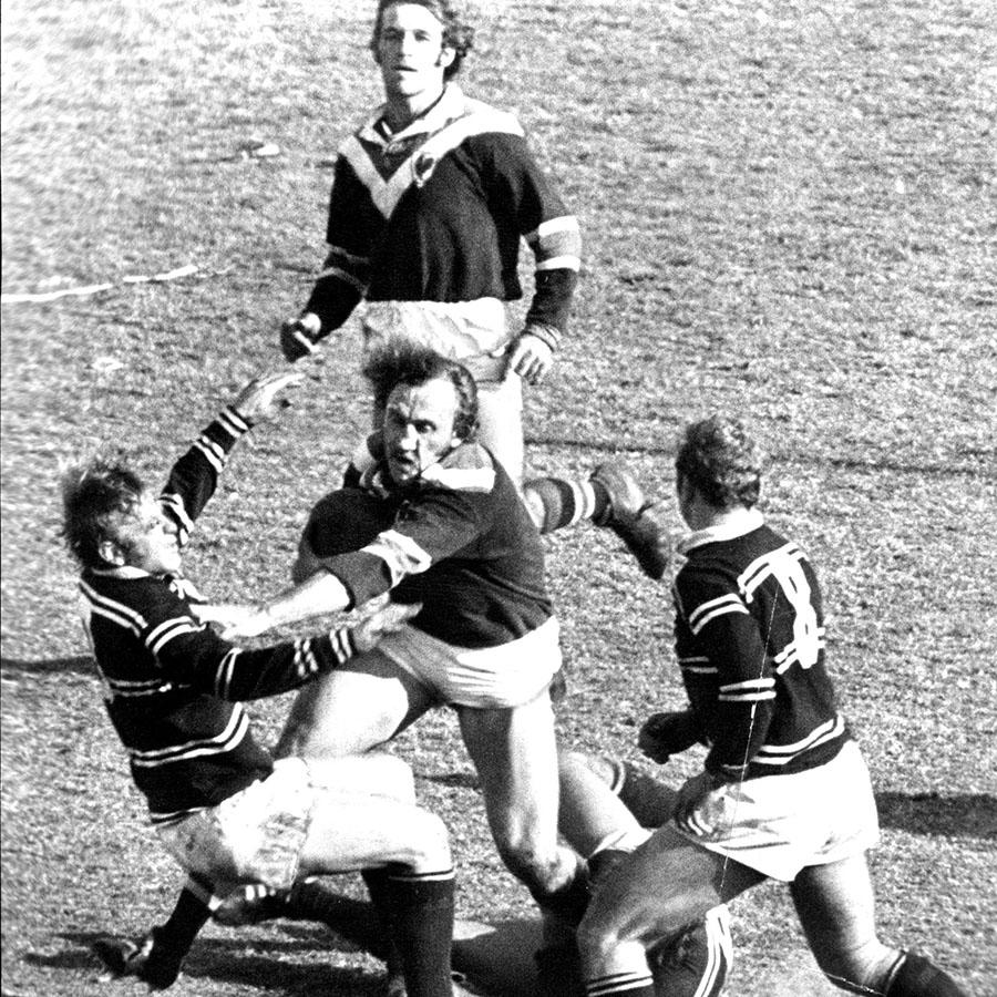Mark Harris, pictured here pushing off Ray Branighan as Harry Cameron watches on.