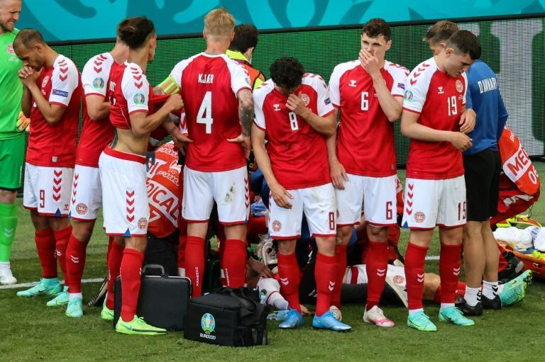Denmark's players formed a protective ring around Christian Eriksen after he suffered a cardiac arrest in their opening match of Euro 2020 against Finland
