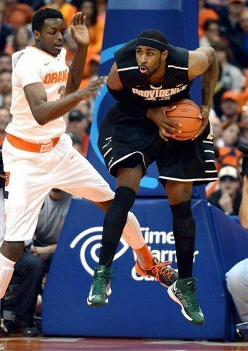 Providence's LaDontae Henton, right, grabs a rebound against Syracuse's Jerami Grant during the first half in an NCAA college basketball game in Syracuse, N.Y., Wednesday, Feb. 20, 2013. (AP Photo/Kevin Rivoli)