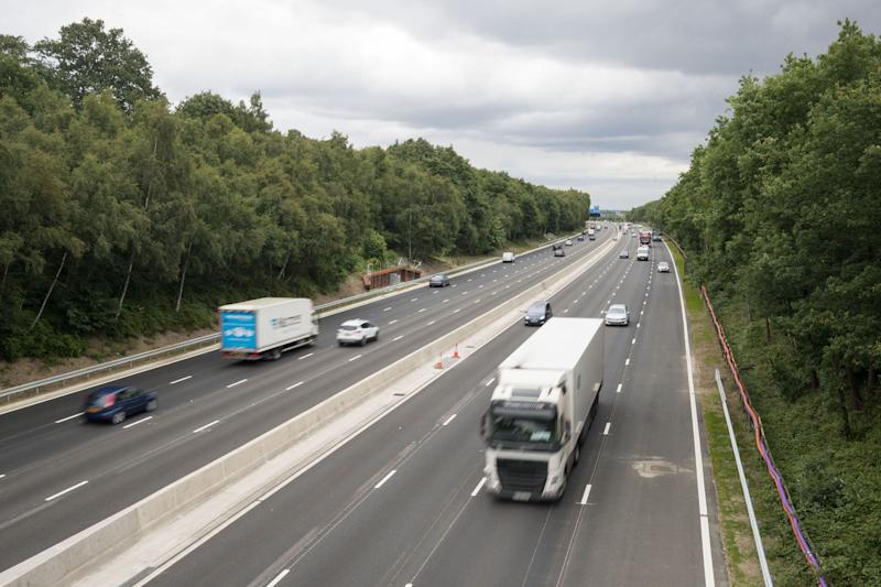 "Vehicles on the new13.4-mile long M3 ""smart"" motorway near Longcross, Surrey, between Farnborough and the M25. (Photo by Steve Parsons/PA Images via Getty Images)"