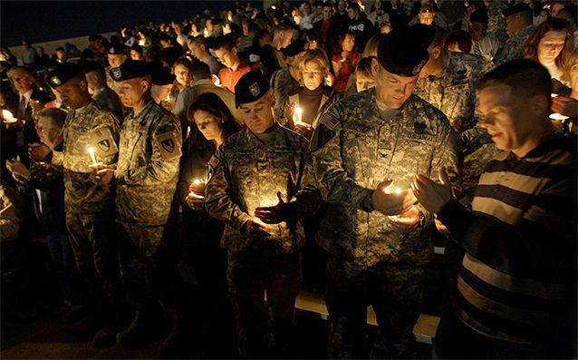 Soldiers hold a candlelight vigil at Fort Hood, Texas where authorities said Maj. Nidal Malik Hasan shot and killed 13 people. Photo: AP/LM Otero