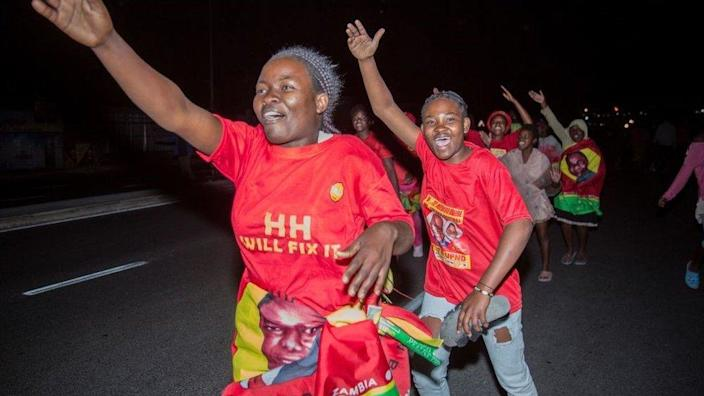 Supporters of the opposition Zambian presidential candidate United Party for National Development (UPND) Hakainde Hichilema celebrate his election to the Zambian presidency in Lusaka on August 16, 2021