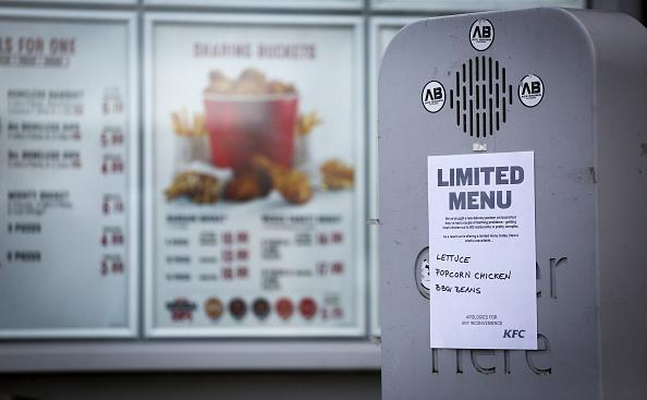 A sign warns that a limited menu is being operated at a branch of KFC due to problems with the delivery of chicken on Feb. 20, 2018 in Bristol, England. KFC has been forced to close hundreds of outlets as a shortage of chicken, due to a failure at the company's new delivery firm DHL, has disrupted the fast-food giant's UK operation. (Photo by Matt Cardy/Getty Images)