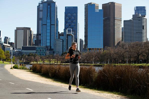People are seen exercising along the Yarra River in Melbourne, Australia.
