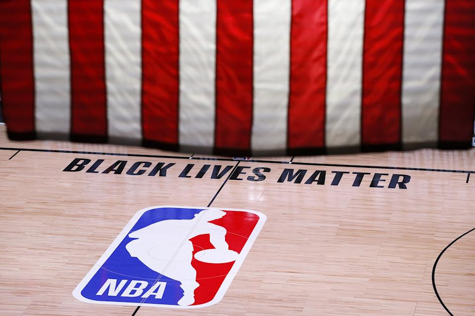 LAKE BUENA VISTA, FLORIDA - AUGUST 26: An empty court and bench is shown following the scheduled start time in Game Five of the Eastern Conference First Round between the Milwaukee Bucks and the Orlando Magic during the 2020 NBA Playoffs at AdventHealth Arena at ESPN Wide World Of Sports Complex on August 26, 2020 in Lake Buena Vista, Florida. The Milwaukee Buck have boycotted game 5 reportedly to protest the shooting of Jacob Blake in Kenosha, Wisconsin. NOTE TO USER: User expressly acknowledges and agrees that, by downloading and or using this photograph, User is consenting to the terms and conditions of the Getty Images License Agreement. (Photo by Kevin C. Cox/Getty Images)