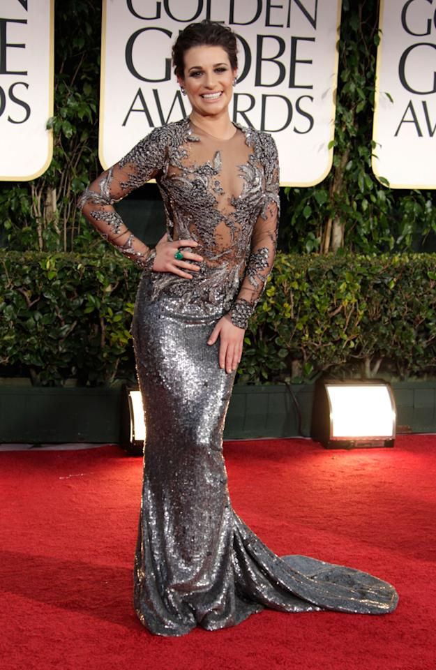 "Lea Michele turned on the shine as she arrived at the 69th Annual Golden Globe Awards held at the Beverly Hilton Hotel on January 15, 2012 in Beverly Hills, California. The 25-year-old ""Glee"" actress wore a Marchesa embroidered illusion long-sleeve gown, Jimmy Choo sandals and jewelry from Lorraine Schwartz.<em><br></em>"