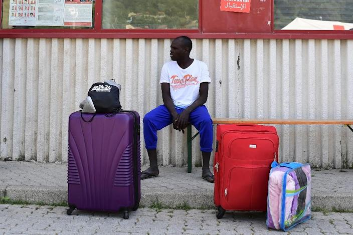 A migrant waits for a a host house at the Italian Red Cross camp in Ventimiglia on June 15, 2018 (AFP Photo/MIGUEL MEDINA)