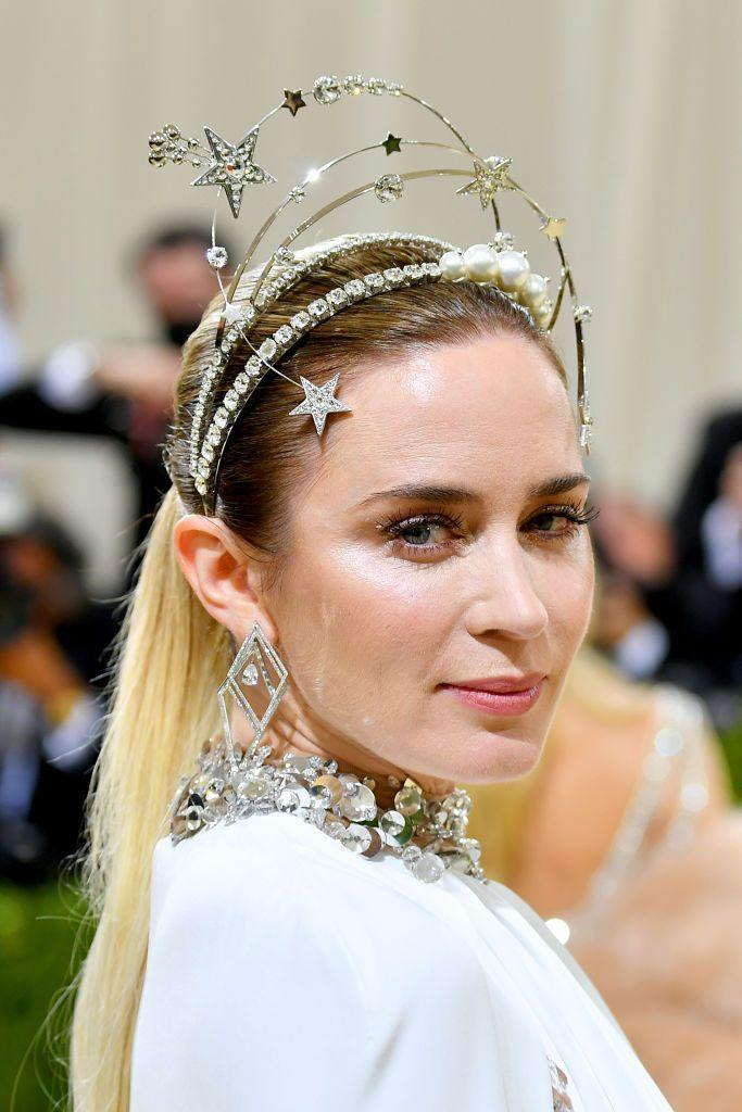 <p>Blunt's beauty look was relatively reserved - save for an otherworldly headband; an extension of her jewelled Miu Miu gown. </p>