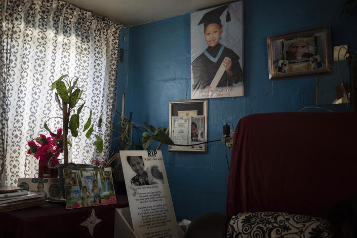 Photos of 8-year-old Tazne van Wyk hang inside her parents' house in Cape Town, South Africa, on Sept. 10, 2020. The girl's body was found in February dumped in a drain near a highway, nearly two weeks after she disappeared. Police said she had been abducted, raped and murdered. (AP Photo/Bram Janssen)