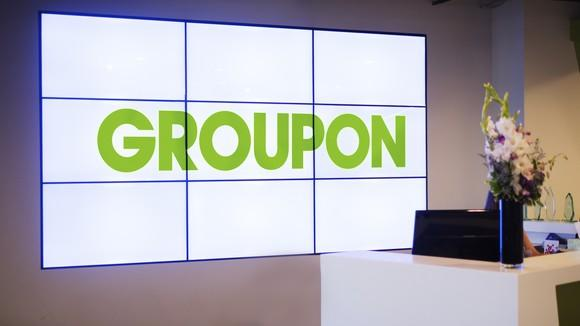 Nine projection TVs spelling out Groupon at the company's HQ.