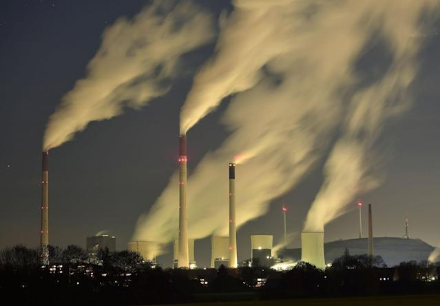 <p>Smoke streams from the chimneys of the E.ON coal-fired power station in Gelsenkirchen, Germany, and with a capacity of around 2300 MW of power it is one of the most powerful coal-fired power stations in Europe, Nov. 24, 2014. Germany announced on Wednesday, Dec. 3, 2014 a cash boost for measures to cut greenhouse gas emissions, in a bid to meet its ambitious climate target for 2020. Germany has pledged to reduce its carbon dioxide output by 40 percent by the end of the decade, compared to 1990s levels. Current estimates predict it will only achieve a 32-35 percent cut. (AP Photo/Martin Meissner) </p>