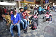 KALYAN, MAHARASHTRA, INDIA - 2020/03/21: People waiting for the Long distance train to various villages at Kalyan railway station during the corona pandemic. All shops, factories and other commercial establishments expect grocery stores, medical stores are to be shut down till 31st March and all citizens of India have been urged to stay indoors for 14 hours. Timings of the 'Janata curfew' (People Curfew) are 7am to 9pm as a social distancing measure to combat the corona virus outbreak. (Photo by Sandeep Rasal/SOPA Images/LightRocket via Getty Images)