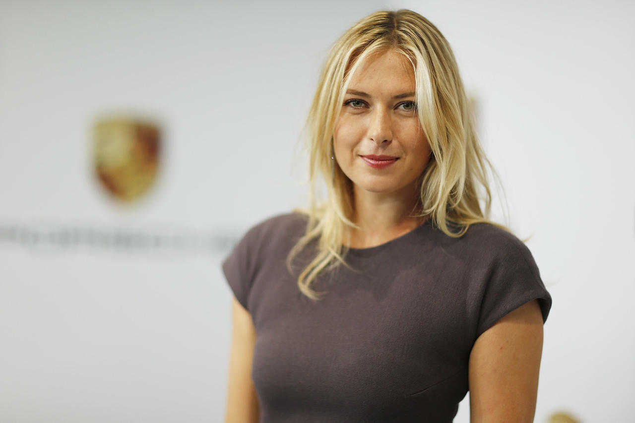 STUTTGART, GERMANY - APRIL 22:  Tennis player Maria Sharapova poses for the media as she is unveiled as car manufacturer Porsche's new brand ambassador at the Porsche Museum on April 22, 2013 in Stuttgart, Germany.  (Photo by Thomas Niedermueller/Getty Images)