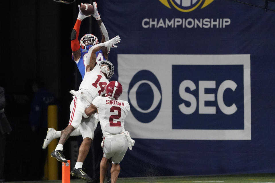 Florida tight end Kyle Pitts (84) makes a touchdown catch against Alabama defensive back Brian Branch (14) during the second half of the Southeastern Conference championship NCAA college football game, Saturday, Dec. 19, 2020, in Atlanta. (AP Photo/John Bazemore)