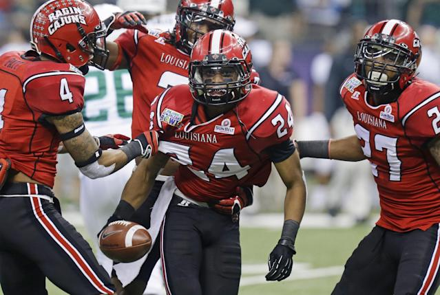 Louisiana-Lafayette cornerback Sean Thomas (24) celebrates after intercepting a Tulane pass during the first half of the New Orleans Bowl NCAA college football game, Saturday, Dec. 21, 2013, in New Orleans. (AP Photo/Bill Haber)