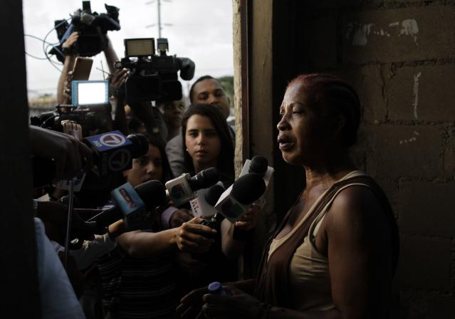 Justina Garcia, the mother of Eddy Vladimir Feliz Garcia, who was taken into custody in connection with the shooting of former Boston Red Sox slugger David Ortiz, talks to the press at court in Santo Domingo, Dominican Republic, Tuesday, June 11 , 2019. Her son's lawyer, Deivi Solano, said Féliz Garcia had no idea who he'd picked up and what was about to happen, and that he expected his client would be charged as an accomplice to an attempted murder. (AP Photo/Roberto Guzman)