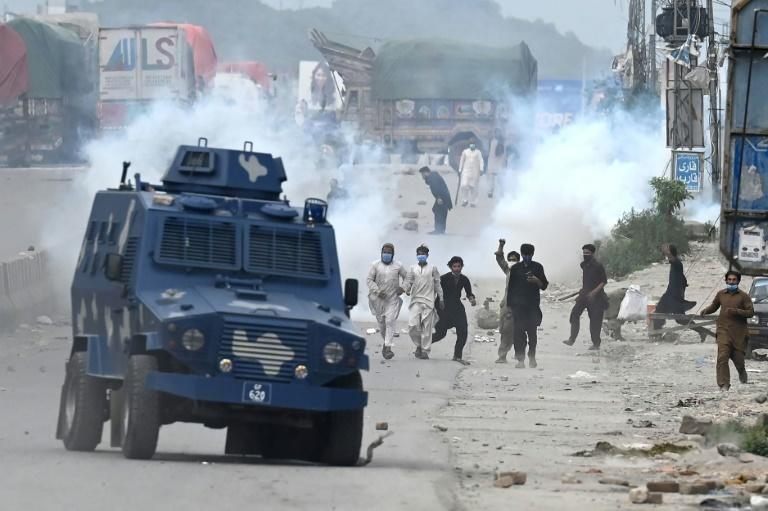 Two police officers died in clashes during which water cannon, tear gas and rubber bullets were used
