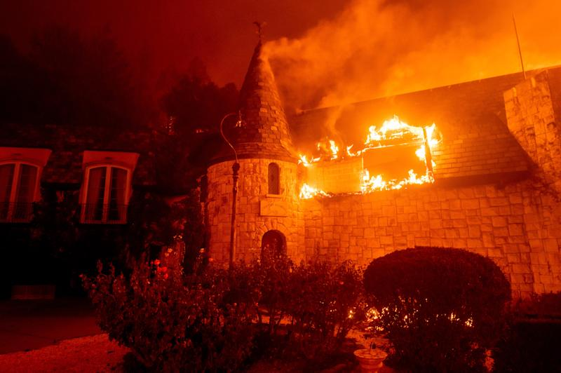 Flames from the Glass Fire consume Chateau Boswell Winery in St. Helena, Calif., Sunday, Sept. 27, 2020. (AP Photo/Noah Berger) ORG XMIT: CANB124