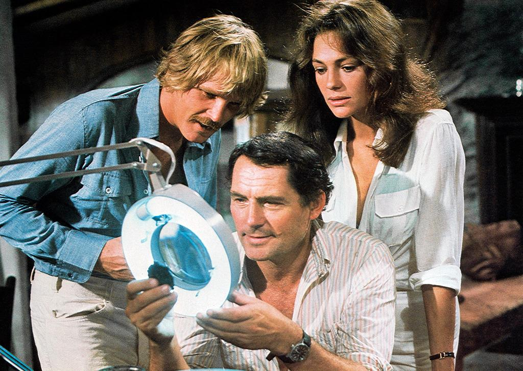 <p>Steven Spielberg's adaptation of Peter Benchley's beach read <em>Jaws</em> more or less invented the summer blockbuster two years prior. Peter Yates's pedestrian version of the author's deep-sea treasure-hunting tale <em>The Deep</em> can't boast a similar achievement, but it did create one enduring image: Jacqueline Bisset in a wet T-shirt. (Photo: Everett)<br /></p>