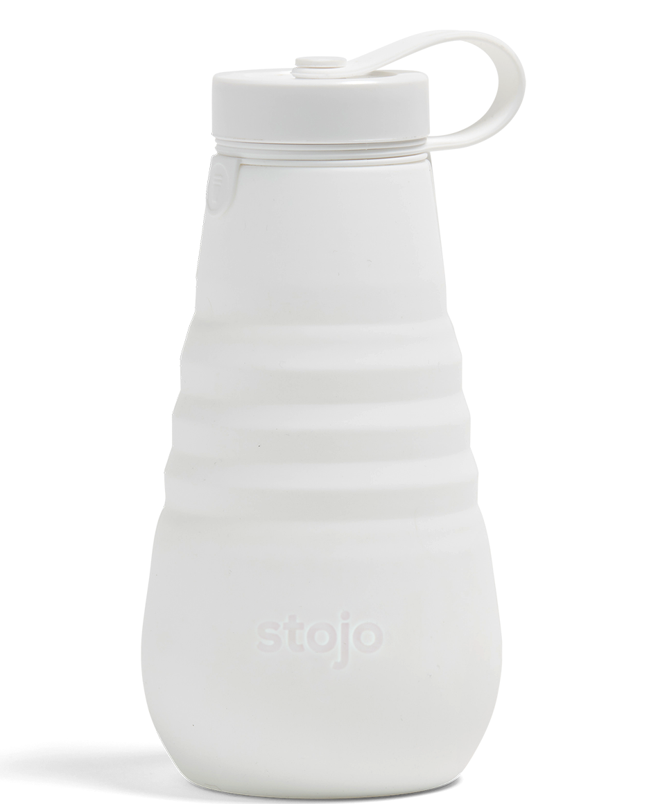 """<h3>Stojo 20oz. Bottle</h3><br>Made with a BPA-free cap and food-safe certified silicone, this collapsible bottle can fit easily in your bag to minimize plastic waste day-to-day. Plus, it's designed to fit together like a puzzle, eliminating the need for harmful glue or chemical adhesives. <br><br><strong>Stojo</strong> 20 oz. Bottle, $, available at <a href=""""https://go.skimresources.com/?id=30283X879131&url=https%3A%2F%2Fstojo.co%2Fproducts%2F20-oz-bottle"""" rel=""""nofollow noopener"""" target=""""_blank"""" data-ylk=""""slk:Stojo"""" class=""""link rapid-noclick-resp"""">Stojo</a>"""