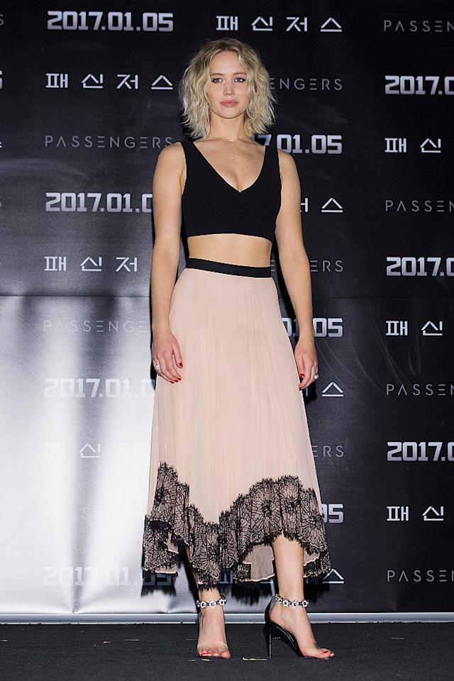 "<p>At a recent press conference for ""Passengers"" in Seoul, South Korea, Lawrence wore a black crop top with a pink midi skirt that featured lace trim. Her heels had diamanté ankle straps, and she stuck with her signature loose waves. (Photo: Getty Images) </p>"