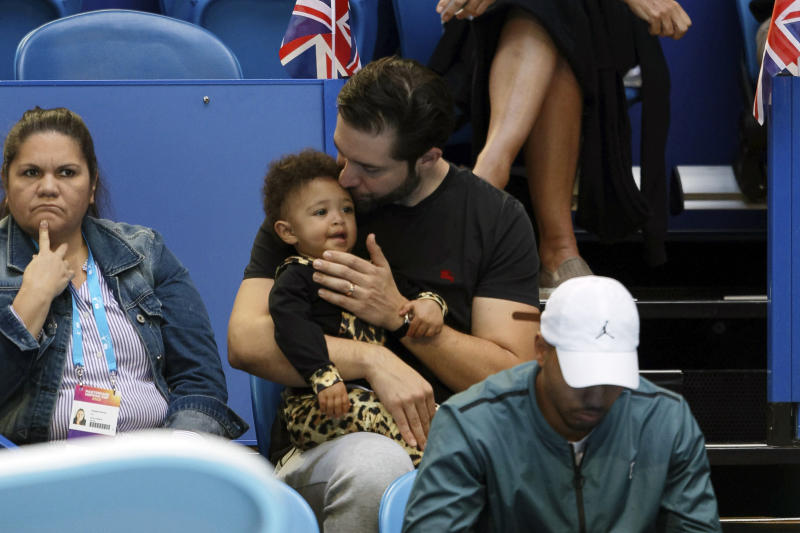 Serena Williams husband Alexis Ohanian holds their daughter Olympia during her match against Britain's Katie Boulter of the Hopman Cup in Perth, Australia, Thursday Jan. 3, 2019. (AP Photo/Trevor Collens)
