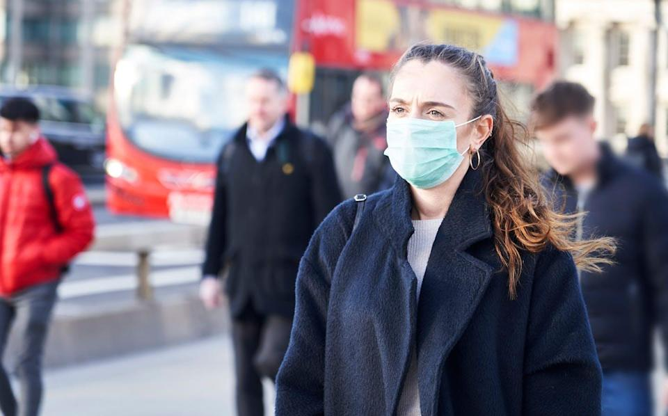 """<span class=""""attribution""""><a class=""""link rapid-noclick-resp"""" href=""""https://www.shutterstock.com/es/image-photo/young-woman-wearing-face-mask-while-1663345954"""" rel=""""nofollow noopener"""" target=""""_blank"""" data-ylk=""""slk:Gemphoto/Shutterstock"""">Gemphoto/Shutterstock</a></span>"""