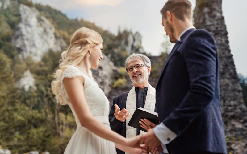 A couple have a religious wedding ceremony with a priest - meaning they are allowed 30 people at their service - Getty