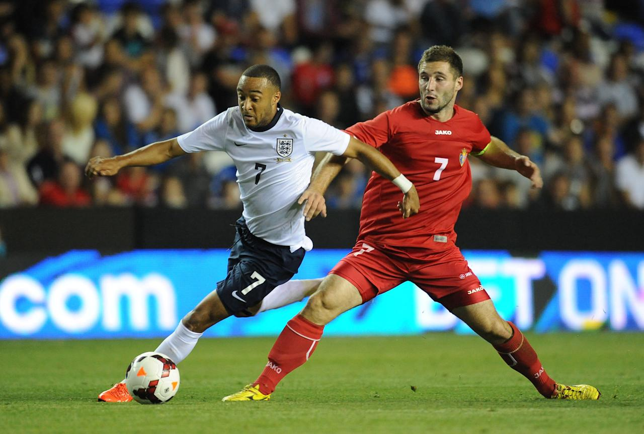England's Nathan Redmond (left) and Moldova's Eugen Zasaviitchi (right) battle for the ballduring the UEFA Euro Under 21's Qualifying match at The Madejski Stadium, Reading.