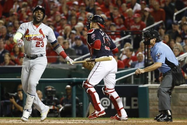 St. Louis Cardinals' Marcell Ozuna reacts after striking out during the second inning of Game 4 of the baseball National League Championship Series against the Washington Nationals Tuesday, Oct. 15, 2019, in Washington. (AP Photo/Patrick Semansky)