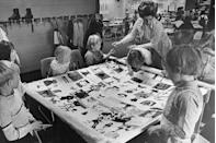 <p>Kids work on a class project making a quilt to celebrate the country's bicentennial.</p>
