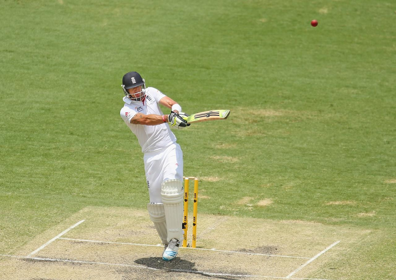 BRISBANE, AUSTRALIA - NOVEMBER 24:  Kevin Pietersen of England hits the ball in the air and is out caught during day four of the First Ashes Test match between Australia and England at The Gabba on November 24, 2013 in Brisbane, Australia.  (Photo by Scott Barbour/Getty Images)