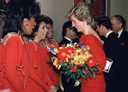<p>All three members of singing group stunned in red long sleeve gowns, finished with gold sequins. It looks like Princess Diana got the memo, too.<br></p>