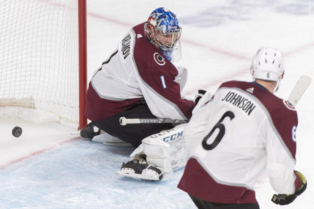 Colorado Avalanche's goaltender Semyon Varlamov looks back on his goal after being scored on by Montreal Canadiens' Jesperi Kotkaniemi as Avalanche's Erik Johnson defends during the third period of an NHL hockey game Saturday, Jan. 12, 2019, in Montreal. (Graham Hughes/The Canadian Press via AP)