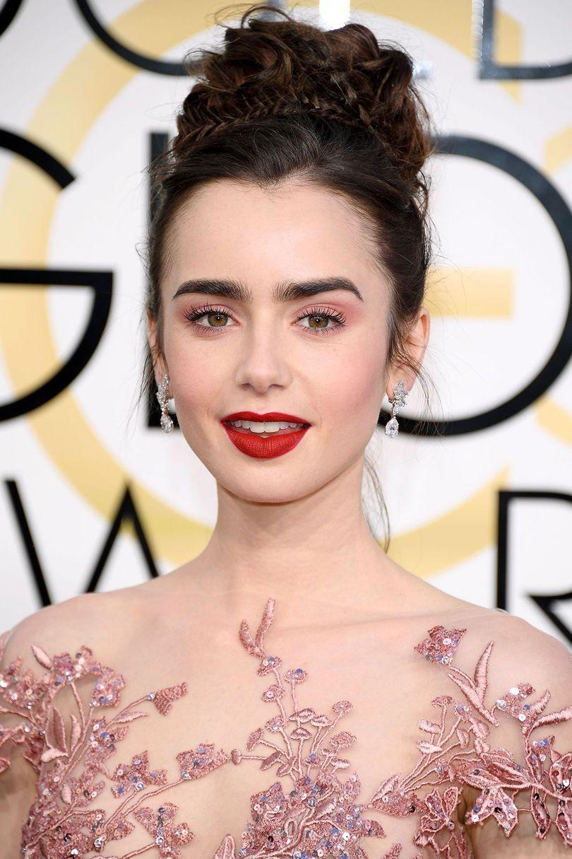 <p>If there's a plait that's not in Lily Collins' elaborate updo we don't know about it. </p>