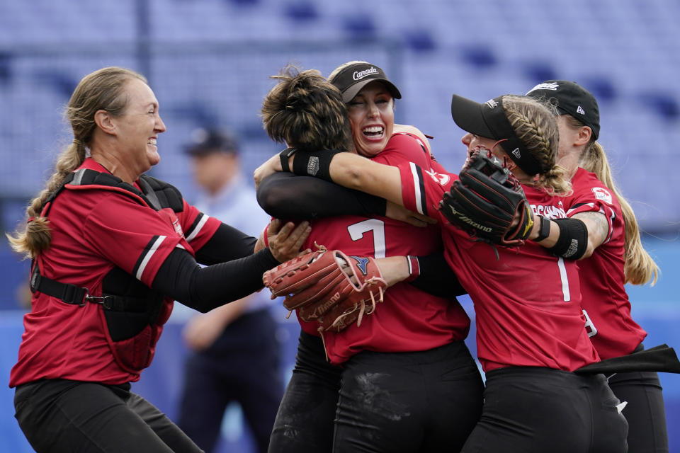 Canada's Danielle Lawrie, center right, celebrate with teammates after a softball game against Mexico at the 2020 Summer Olympics, Tuesday, July 27, 2021, in Yokohama, Japan. Canada won 3-2. (AP Photo/Sue Ogrocki)
